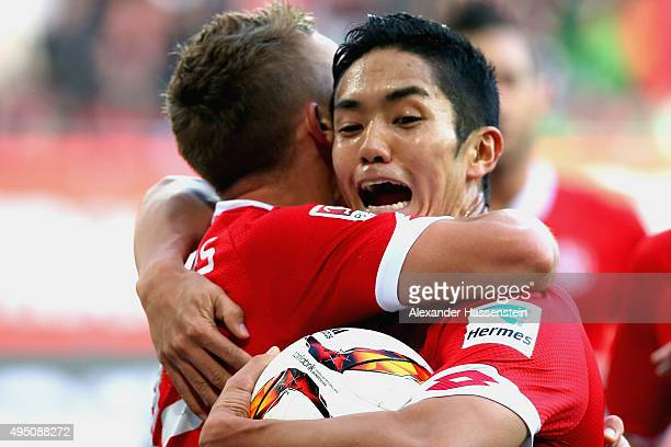 Yoshinori Muto of Mainz celebrates scoring the opening goal with his team mate Pablo De Blasis during the Bundesliga match between FC Augsburg and 1...