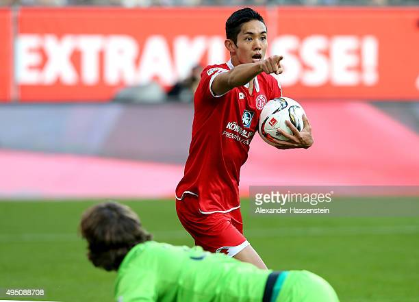 Yoshinori Muto of Mainz celebrates scoring the opning goal during the Bundesliga match between FC Augsburg and 1 FSV Mainz 05 at WWK Arena on October...