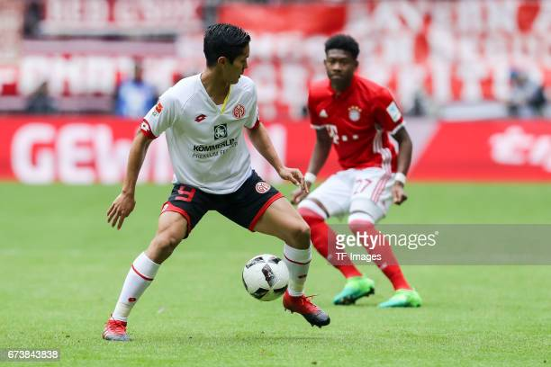 Yoshinori Muto of Mainz controls the ball during the Bundesliga match between Bayern Muenchen and 1 FSV Mainz 05 at Allianz Arena on April 22 2017 in...