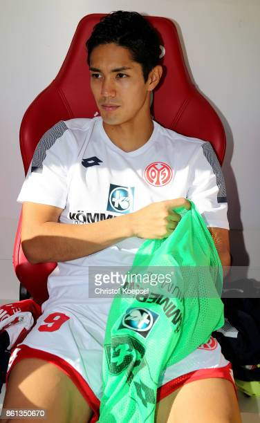 Yoshinori Muto of Mainz sits on the bench during the Bundesliga match between 1 FSV Mainz 05 and Hamburger SV at Opel Arena on October 14 2017 in...