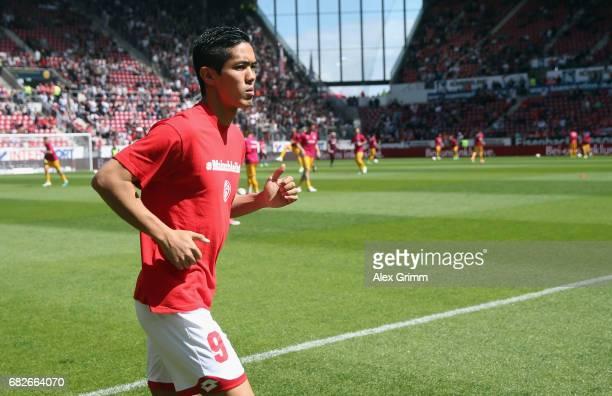 Yoshinori Muto of Mainz warms up prior to the bench prior to the Bundesliga match between 1 FSV Mainz 05 and Eintracht Frankfurt at Opel Arena on May...