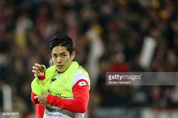 Yoshinori Muto of Mainz warms up prior to the Bundesliga match between 1 FSV Mainz 05 and VfB Stuttgart at Coface Arena on December 11 2015 in Mainz...