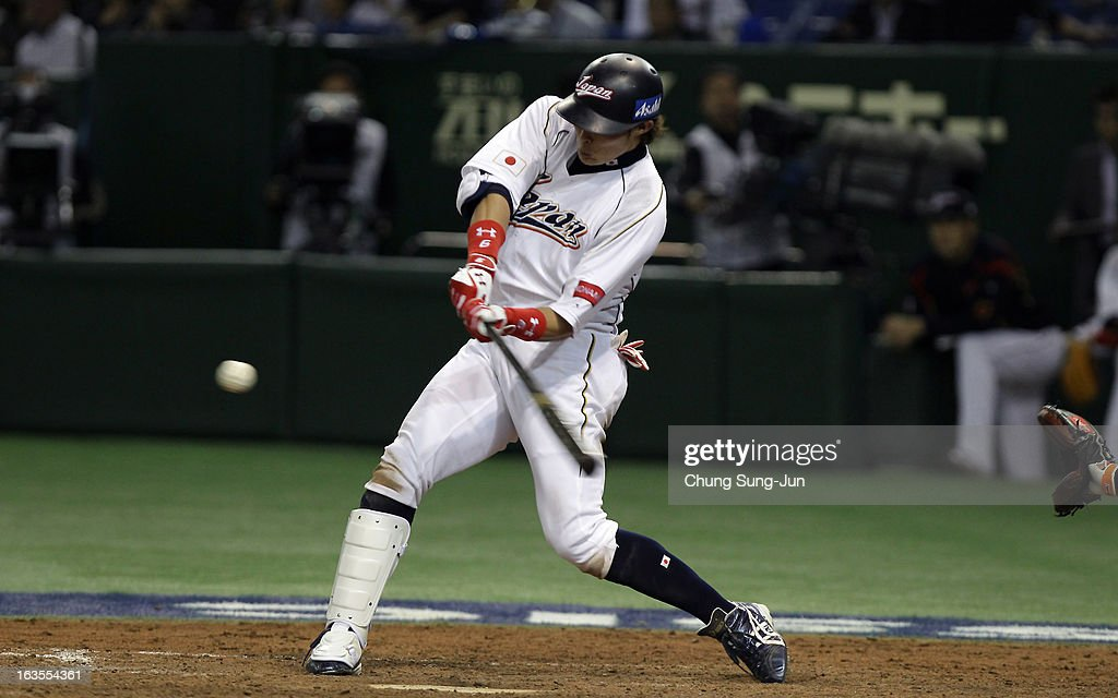 Yoshio Itoi of Japan bats in the seventh inning during the World Baseball Classic Second Round Pool 1 game between Japan and the Netherlands at Tokyo...