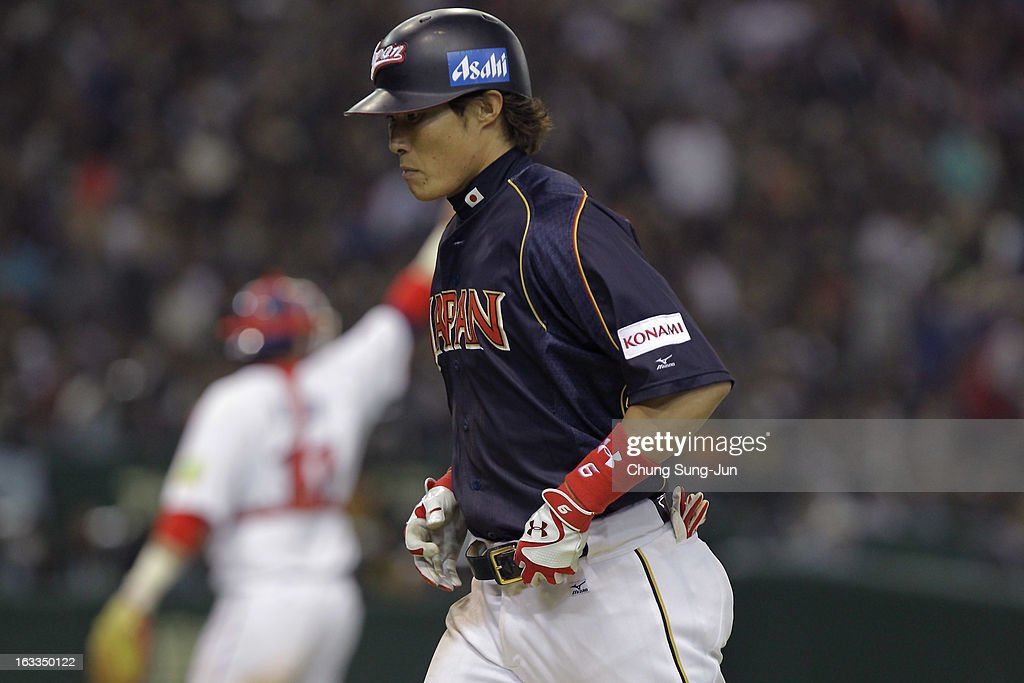 Yoshio Itoi of Japan reacts after fly out in the sixth inning during the World Baseball Classic Second Round Pool 1 game between Japan and Chinese...
