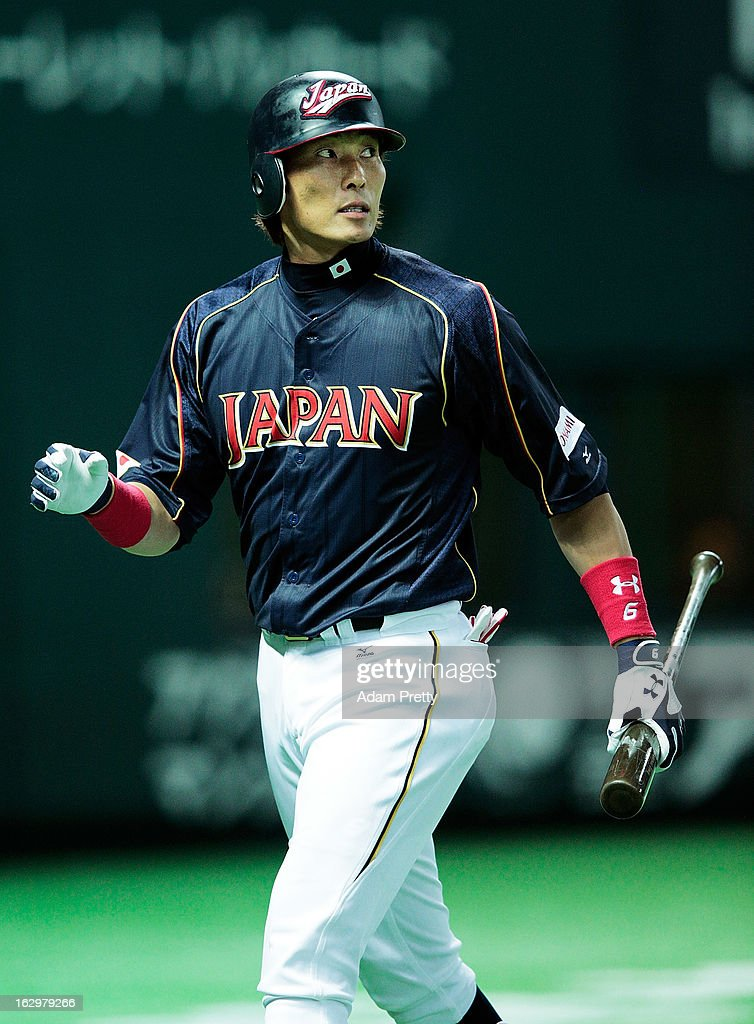 Yoshio Itoi of Japan walks off the field after getting out during the World Baseball Classic First Round Group A game between Brazil and Japan at...