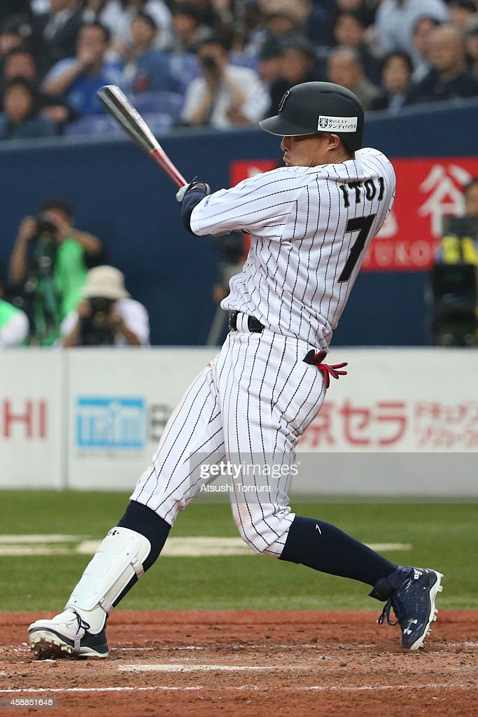 Yoshio Itoi of Samurai Japan bats in the seventh inning during the Game one of Samurai Japan and MLB All Stars at Kyocera Dome Osaka on November 12...