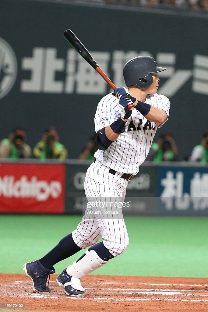 Yoshio Itoi of Samurai Japan hits a single in fourth inning during the game five of Samurai Japan and MLB All Stars at Sapporo Dome on November 18...