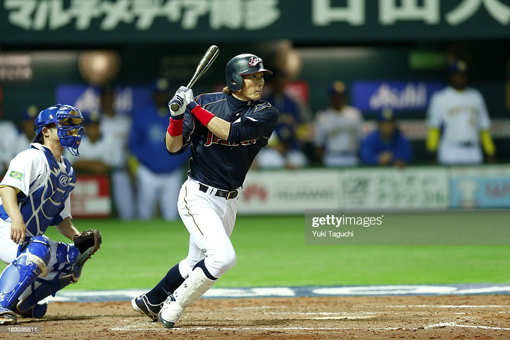 Yoshio Itoi of Team Japan hits a RBI single in the top of the third inning during Pool A Game 1 between Team Japan and Team Brazil during the first...