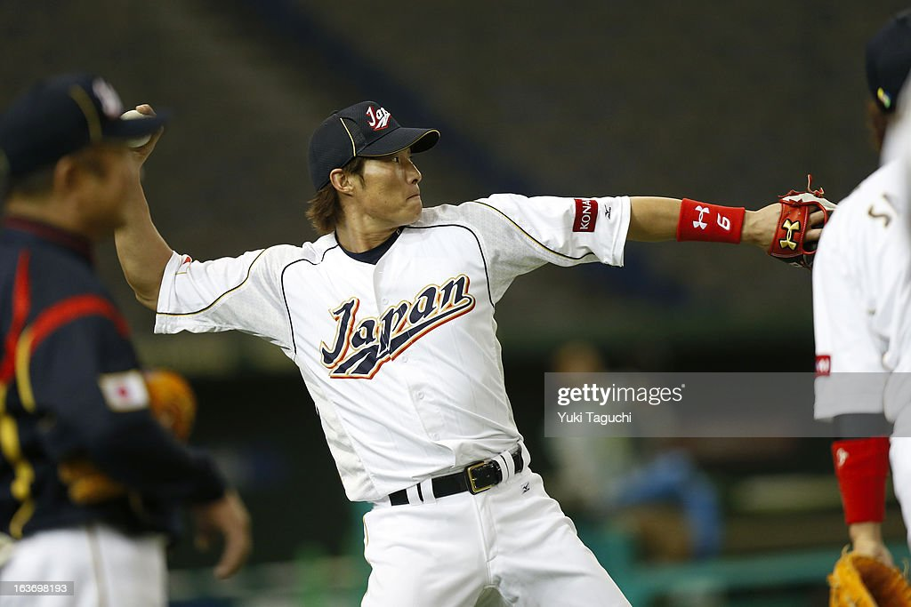 Yoshio Itoi of Team Japan plays catch in the outfield during the 2013 World Baseball Classic workout day at the Tokyo Dome on March 7 2013 in Tokyo...