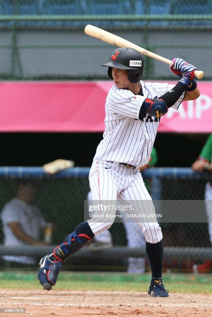 Yoshitaka Nagasawa #24 of Japan bats against Mexico during the Baseball Group B match between Japan and Mexico during the Universiade Taipei at the Xinzhuang Baseball Stadium on August 22, 2017 in Taipei, Taiwan.