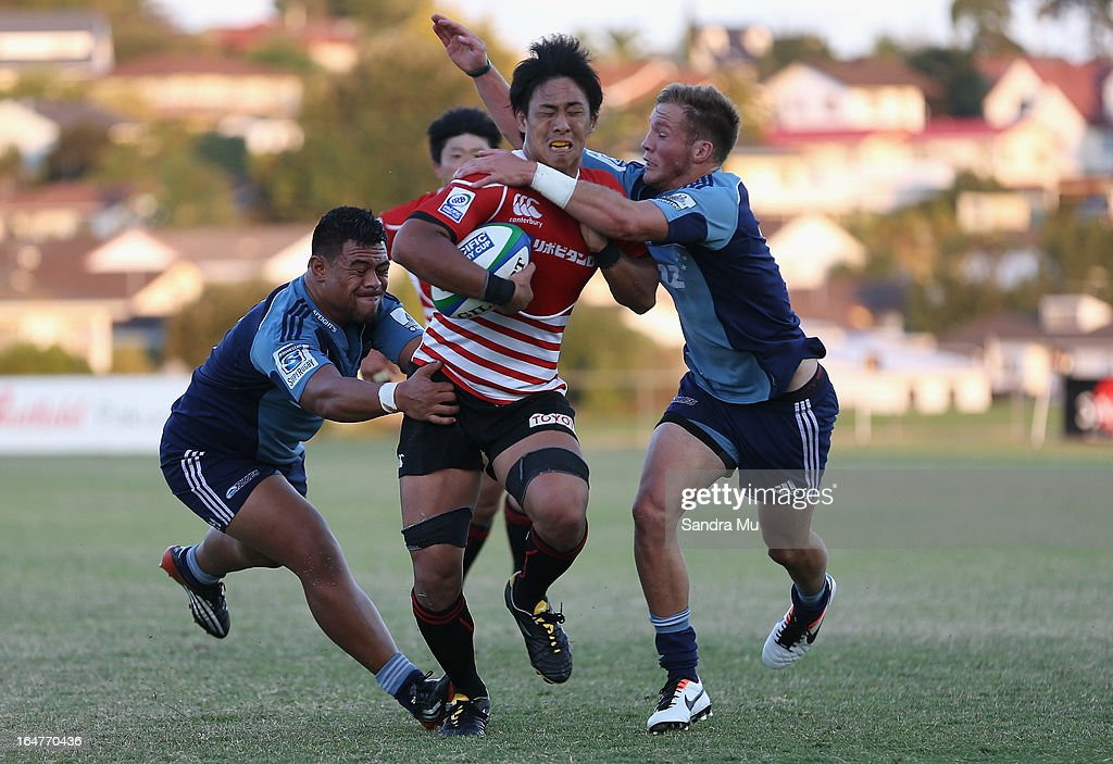 Yoshitaka Tokunaga of Japan is tackled during the Pacific Rugby Cup match between the Blues Development and Junior Japan at Bell Park on March 28, 2013 in Auckland, New Zealand.