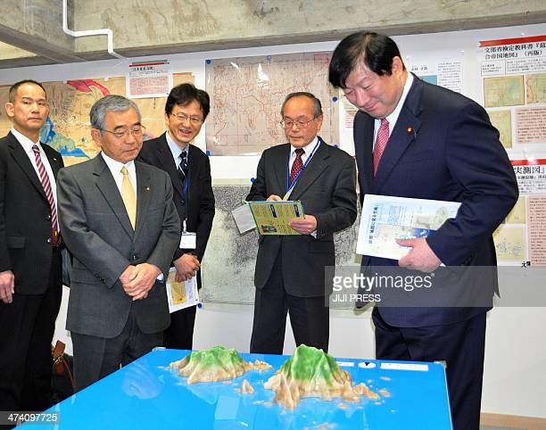 Yoshitami Kameoka Parliamentary Secretary of Japan's Cabinet Office looks at a model of the disputed islnads Takeshima in Japanese and Dokdo in...
