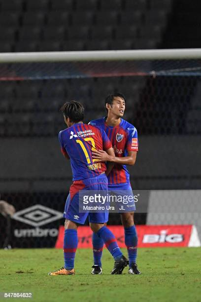 Yoshito Okubo and Takuji Yonemoto of FC Tokyo celebrate their team's 10 victory in the JLeague J1 match between FC Tokyo and Vegalta Sendai at...