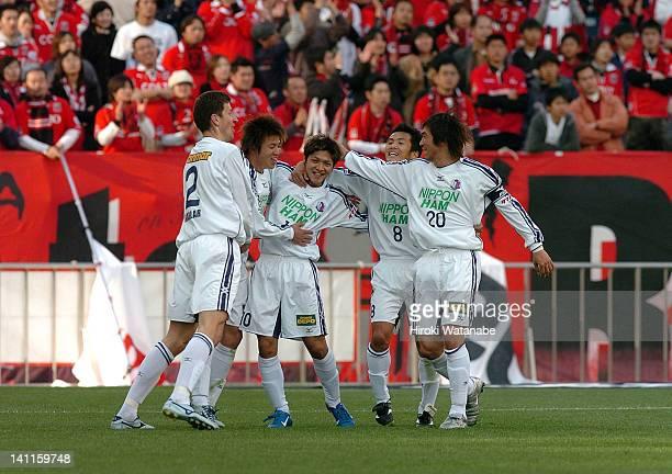 Yoshito Okubo of Cerezo Osaka celebrates the goal with his teammates during the JLeague match between Urawa Red Diamonds and Cerezo Osaka at Saitama...
