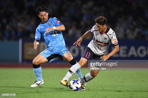 Yoshito Okubo of FC Tokyo and Akihiro Ienaga of Kawasaki Frontale compete for the ball during the JLeague Levain Cup quarter final first leg match...