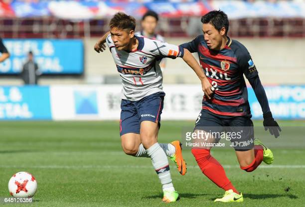 Yoshito Okubo of FC Tokyo and Gen Shoji of Kashima Antlers compete for the ball during the JLeague J1 match between Kashima Antlers and FC Tokyo at...