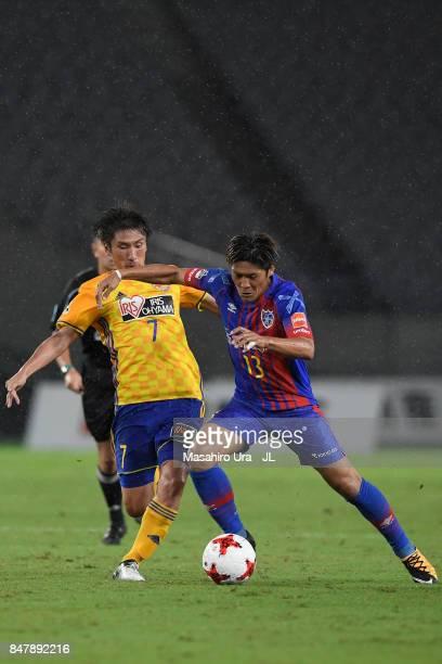 Yoshito Okubo of FC Tokyo and Hiroaki Okuno of Vegalta Sendai compete for the ball during the JLeague J1 match between FC Tokyo and Vegalta Sendai at...