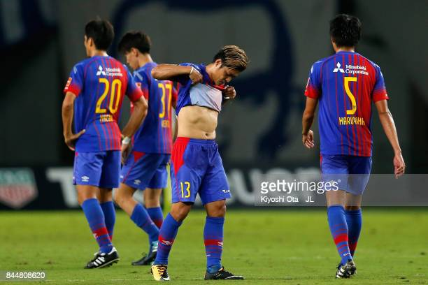 Yoshito Okubo of FC Tokyo and his team mates show dejection after his side's 14 defeat in the JLeague J1 match between FC Tokyo and Cerezo Osaka at...