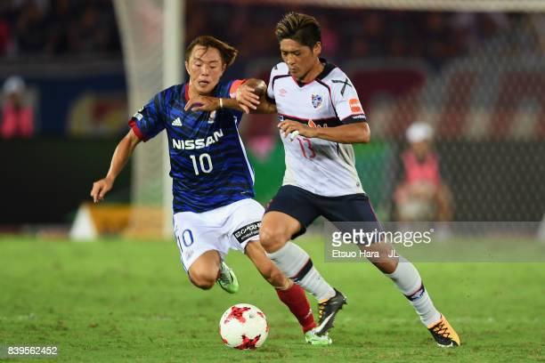 Yoshito Okubo of FC Tokyo and Manabu Saito of Yokohama FMarinos compete for the ball during the JLeague J1 match between Yokohama FMarinos and FC...