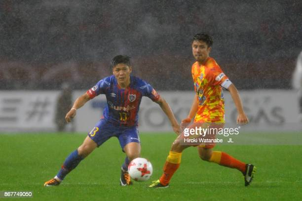 Yoshito Okubo of FC Tokyo and Ryo Takeuchi of Shimizu SPulse compete for the ball during the JLeague J1 match between FC Tokyo and Shimizu SPulse at...