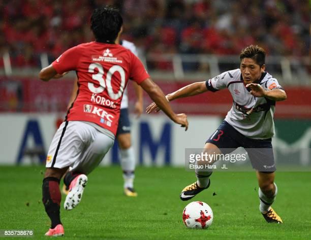 Yoshito Okubo of FC Tokyo and Shinzo Koroki of Urawa Red Diamonds compete for the ball during the JLeague J1 match between Urawa Red Diamonds and FC...
