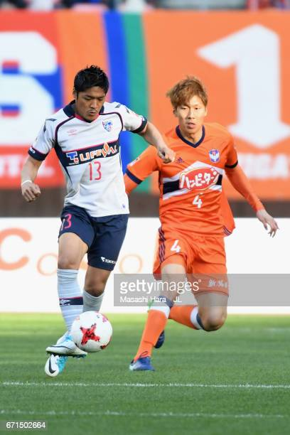 Yoshito Okubo of FC Tokyo and Song Ju Hun of Albirex Niigata compete for the ball during the JLeague J1 match between Albirex Niigata and FC Tokyo at...