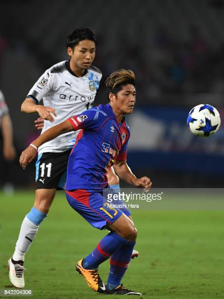 Yoshito Okubo of FC Tokyo and Yu Kobayashi of Kawasaki Frontale compete for the ball during the JLeague Levain Cup quarter final second leg match...