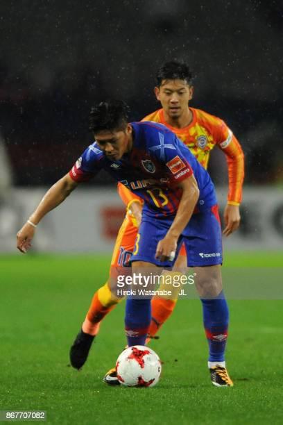 Yoshito Okubo of FC Tokyo controls the ball under pressure of Ryohei Shirasaki of Shimizu SPulse during the JLeague J1 match between FC Tokyo and...