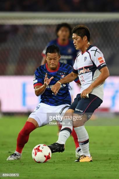 Yoshito Okubo of FC Tokyo controls the ball under pressure of Takuya Kida of Yokohama FMarinos during the JLeague J1 match between Yokohama FMarinos...