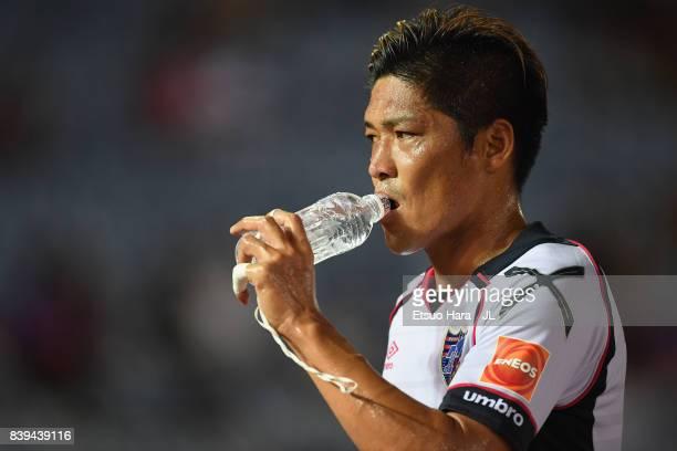 Yoshito Okubo of FC Tokyo drinks water during the JLeague J1 match between Yokohama FMarinos and FC Tokyo at Nissan Stadium on August 26 2017 in...