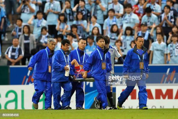 Yoshito Okubo of FC Tokyo is stretched off after an injury during the JLeague J1 match between Jubilo Iwata and FC Tokyo at Yamaha Stadium on June 25...