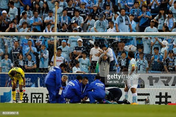 Yoshito Okubo of FC Tokyo receives medical treatment before stretched off after an injury during the JLeague J1 match between Jubilo Iwata and FC...