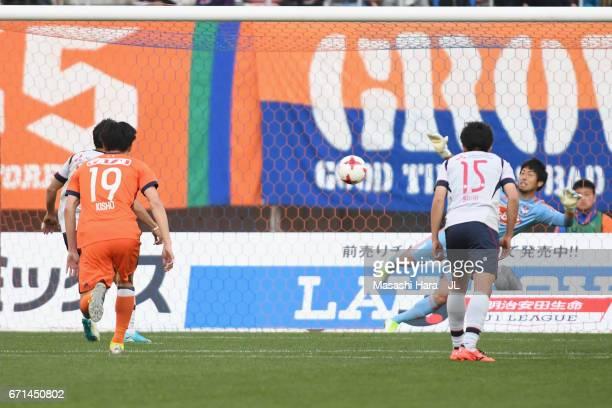 Yoshito Okubo of FC Tokyo scores his side's third goal during the JLeague J1 match between Albirex Niigata and FC Tokyo at Denka Big Swan Stadium on...