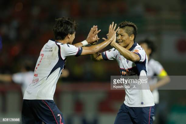 Yoshito Okubo of FC Tokyo scores his team's second goal with his team mate Sei Muroya during the JLeague J1 match between Omiya Ardija and FC Tokyo...