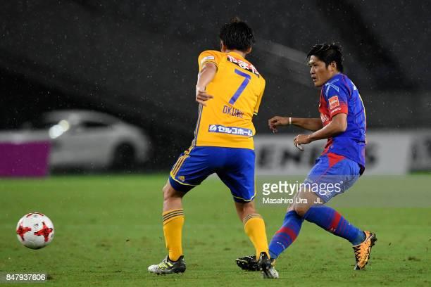 Yoshito Okubo of FC Tokyo takes on Hiroaki Okuno of Vegalta Sendai during the JLeague J1 match between FC Tokyo and Vegalta Sendai at Ajinomoto...