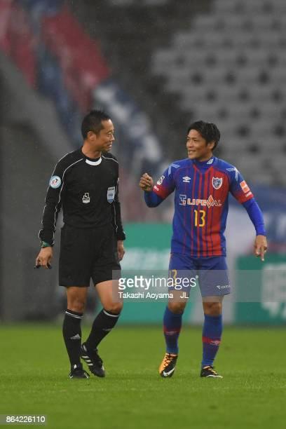 Yoshito Okubo of FC Tokyo talks to referee Minoru Tojo during the JLeague J1 match between FC Tokyo and Consadole Sapporo at Ajinomoto Stadium on...