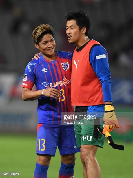 Yoshito Okubo of FC Tokyo talks with Shota Arai of Kawasaki Frontale during the JLeague Levain Cup quarter final second leg match between FC Tokyo...