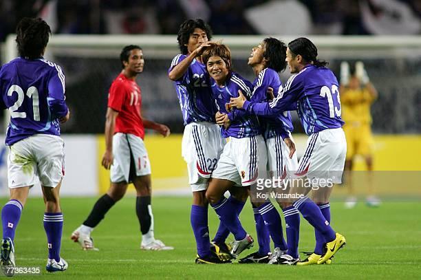 Yoshito Okubo of Japan celebrates after scoring with his teammate Yuji Nakazawa during the AFC Challenge Cup match between Japan and Egypt at Nagai...