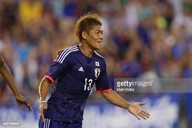 Yoshito Okubo of Japan celebrates scoring a goal during the International Friendly Match between Japan and Zambia at Raymond James Stadium on June 6...