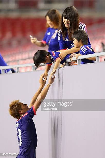 Yoshito Okubo of Japan celebrates with his family after victory during the International Friendly Match between Japan and Zambia at Raymond James...