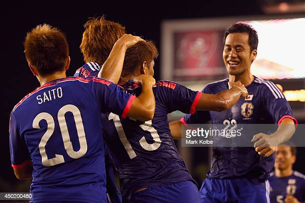 Yoshito Okubo of Japan celebrates with his team after scoring a goal during the International Friendly Match between Japan and Zambia at Raymond...
