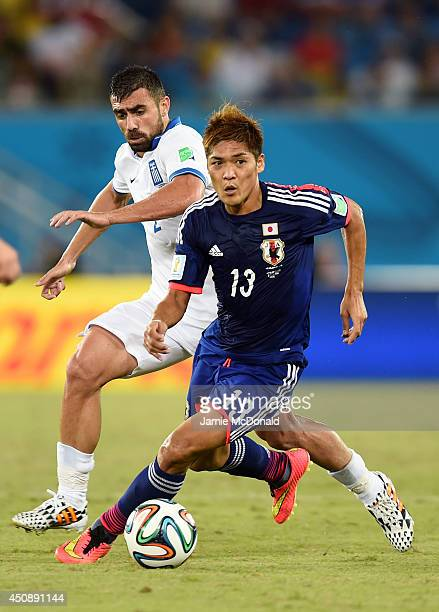 Yoshito Okubo of Japan controls the ball against Giannis Maniatis of Greece during the 2014 FIFA World Cup Brazil Group C match between Japan and...