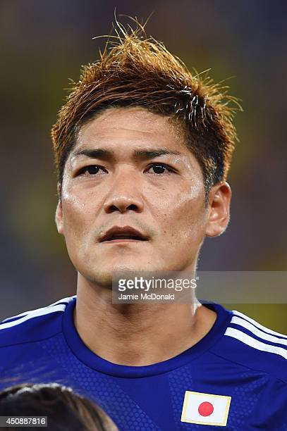 Yoshito Okubo of Japan looks on during the National Anthem prior to the 2014 FIFA World Cup Brazil Group C match between Japan and Greece at Estadio...