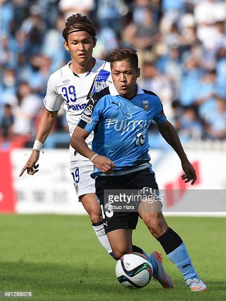 Yoshito Okubo of Kawasaki Frontale and Takashi Usami of Gamba Osaka compete for the ball during the JLeague match between Kawasaki Frontale and Gamba...