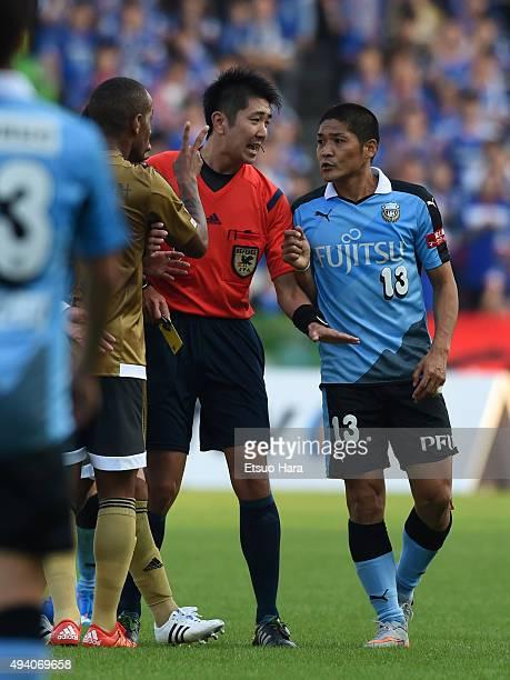 Yoshito Okubo of Kawasaki Frontale appeals to referee Kazuyoshi Enomoyo during the J League match between Kawasaki Frontale and Yokohama FMarinos at...