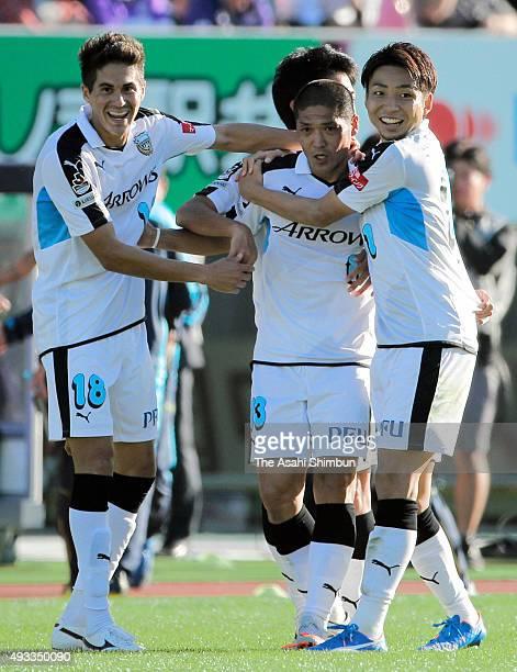 Yoshito Okubo of Kawasaki Frontale celebrates scoring his team's first goal wiwth his team mates during the JLeague match between Sanfrecce Hiroshima...