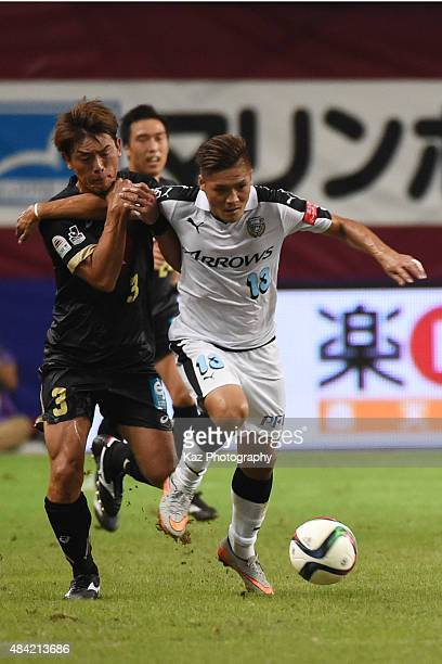 Yoshito Okubo of Kawasaki Frontale dribbles the ball under the pressure from Takahito Soma of Vissel Kobe during the JLeague match between Vissel...