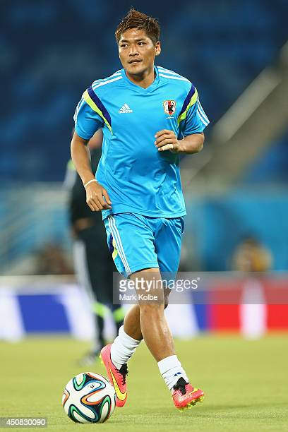 Yoshito Okubo runs with the ball during a Japan training session at the Dunas Arena in Natal on June 18 2014 in Natal Rio Grande do Norte