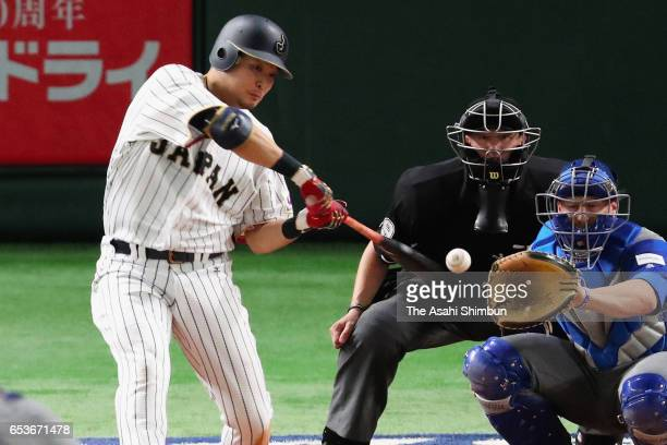 Yoshitomo Tsutsugo of Japan hits a solo homer in the bottom of during the World Baseball Classic Pool E Game Six between Israel and Japan at the...