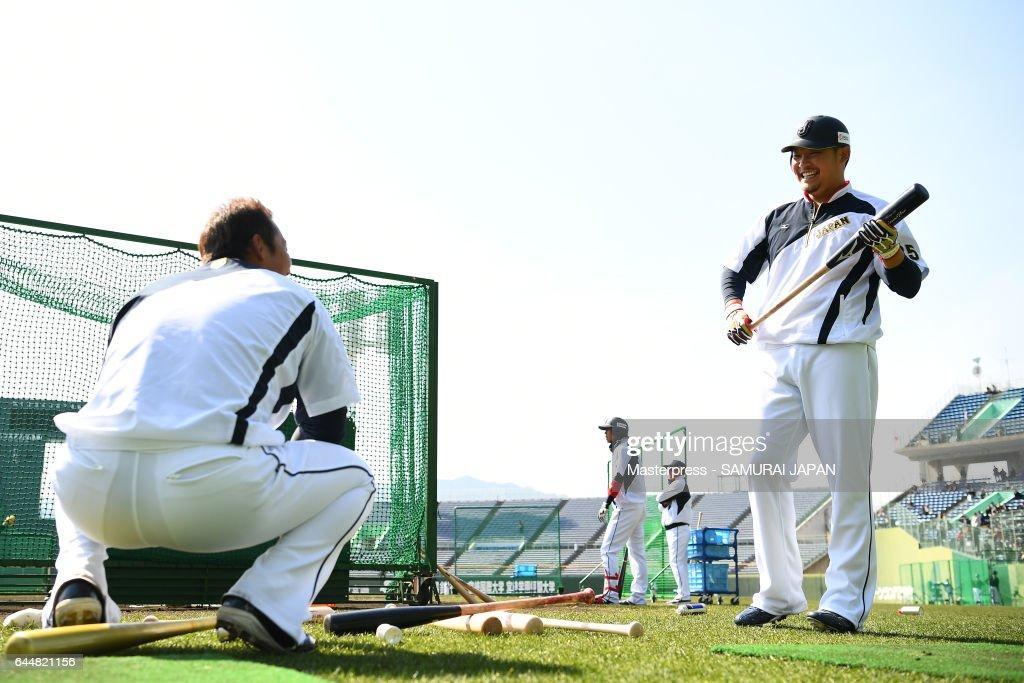 Yoshitomo Tsutsugo #25(R) of Japan looks on during SAMURAI JAPAN's training camp at the Sun Marine Stadium Miyazaki on February 24, 2017 in Miyazaki, Japan.